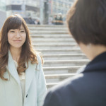 What does smile mean in Japan?