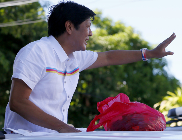 "In this Feb. 22, 2016 photo, Vice-presidential candidate Sen. Ferdinand ""Bongbong"" Marcos Jr. waves to supporters during his campaign sortie in Muntinlupa city, southeast of Manila, Philippines. Three decades after a ""people power"" revolt ousted his dictator father, Sen. Ferdinand Marcos Jr. was wooing voters on the campaign trail this week in his bid to become the Philippines' next vice president. (AP Photo/Bullit Marquez)"
